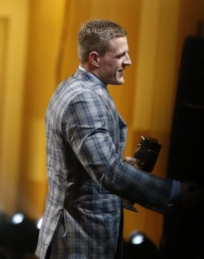 J.J. Watt, of the Houston Texans, accepts the AP defensive player of the year award on stage at the 4th annual NFL Honors at the Phoenix Convention Center Symphony Hall on Saturday, Jan. 1, 2015. (Photo by Colin Young-Wolff/Invision for NFL/AP Images)