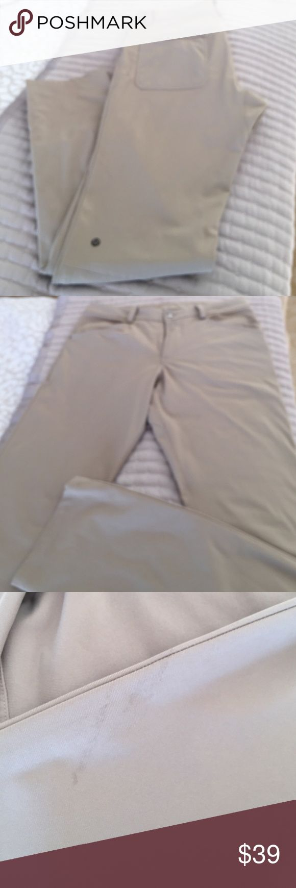 Men's Lululemon Kahki Pants Size 32 Hardly worn. If you are a person who can treat a few very very slight stains you will think these are brand new. I didn't even see the marks on these until I started taking the pictures. You will probably be able to get these very very light stains out in one wash. So hard to find these men's pants in this color. Never altered. Length is at least 32. Like I said. Has a few very slight slight marks. Any good laundry person can get this out or if not when…