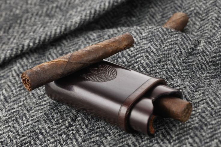 "Hand rolled cigars, like this Toscano Ammezzato (literally ""cut in half""), have been part of the Tuscan country life style for centuries. © Manifatture Sigaro Toscano"