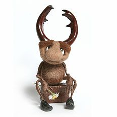 """IRINA EGOROVA - (acicularis) -- """"Of the trip"""" -- Height 10 cm. dolls and if no horns, then 6.5 cm., 3 cm. suitcase on the greatest width.  Materials: wool, wire, floss, plastic.  -- A prototype of the insect world - stag beetle (Lucanus cervus)."""