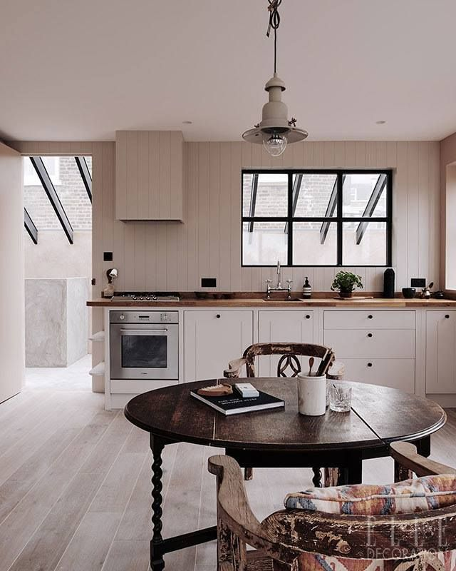 London Calling: Architects Chan + Eayrs have created a cool, calm oasis in in their apartment in the heart of the city. The palette: tongue and groove panelling, textural concrete, wide-plank oiled oak floors and sweeps of blush pink paint (Setting Plaster by Farrow & Ball) is simple and serene