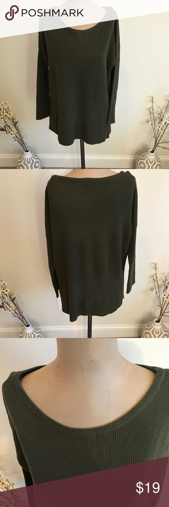 Zara Double Split Knit Sweater Double Split Knit Sweater by Zara. Olive Green. Double side split design. Comfy fit for the cooler temperatures. Used condition. Small hole in the armpit of the Sweater. See pictures. Zara Sweaters