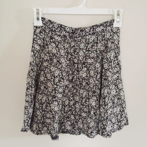 Host pick  Brandy Melville floral skirt Brandy Melville beautiful floral skirt. Perfect, NWOT condition. Has buttons along the front and elastic on the back for some stretch. No trades. Price is firm due to fees. Brandy Melville Skirts