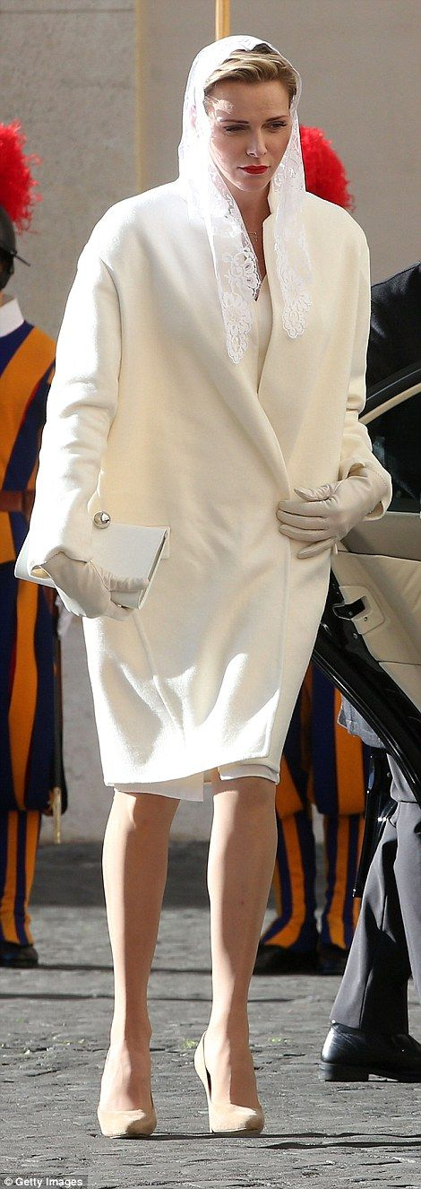 Princess Charlene stepped out of her chauffeur-driven car into the bright Italian sunshine wearing a white lace veil and collarless winter coat