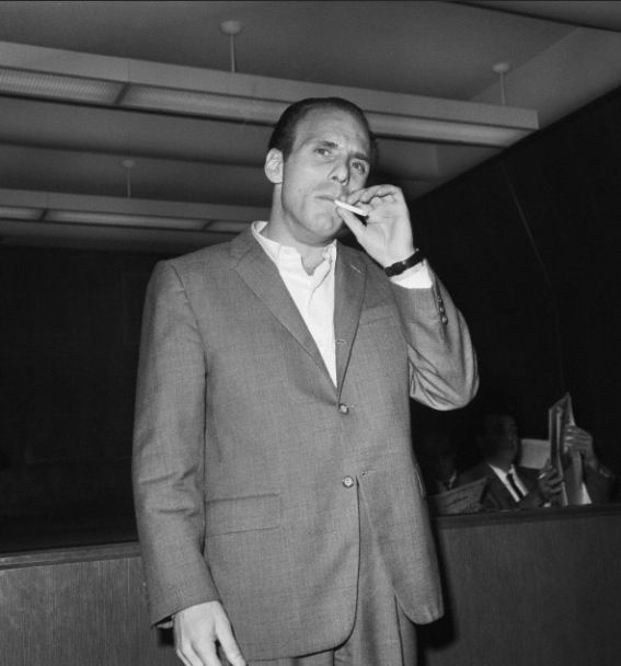 Crazy Joe Gallo smoking a cigarette