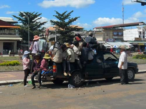 Stung Treng and the road to the border, how many people fit on a pickup truck?