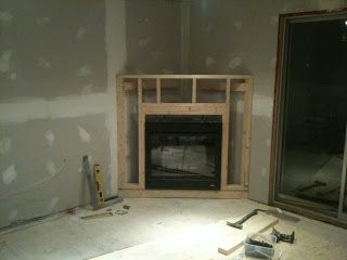 Building a corner electric fireplace  I really would love this in our livingroom!
