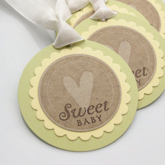 Cute idea for name tags on the front, and maybe on the back they have to write their favorite baby food recipe that thier kids loved, and turn it in at the end <3. OR send them with the invites, and have them fill it out and wear it when they come, and before they leave turn it in <3.