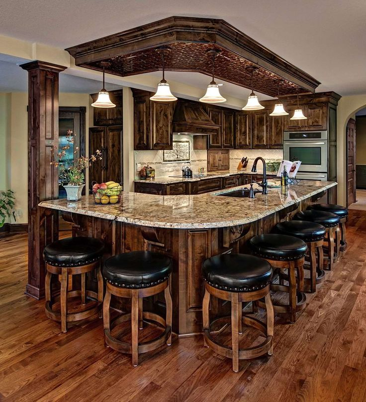 chic-traditional-kitchen-ideas-with-textured-wood-floor-and-l-shape-brown-kitchen-cabinet-combine-marble-frosted-countertop-added-black-laminated-bar-stool.jpg (1164×1280)