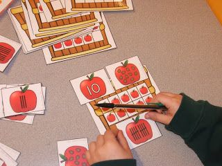 Free: fall apple themed math station activity.  Includes numerals, number sets, tally marks and ten frames