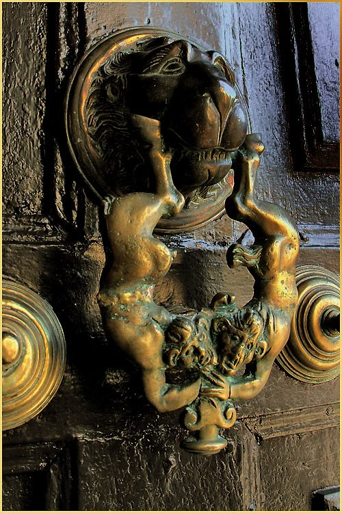 Old Spanish church door-knocker with devils                                                                                                                                                                                 Mais