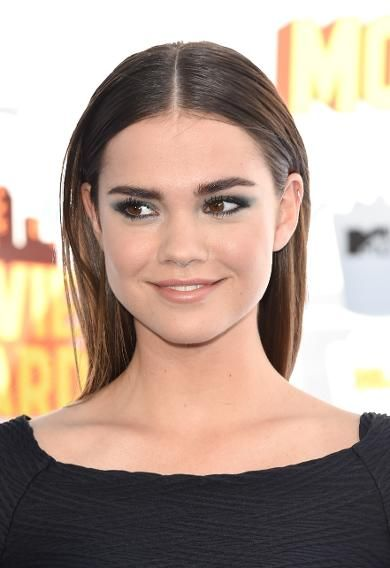 Actress Maia Mitchell's kohl-lined smoky eyes and slicked back straight hair made for an elegant and timeless combination.