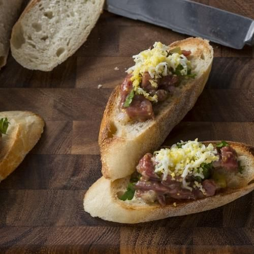 Steak Tartare Crostini with Shaved Egg and Chives