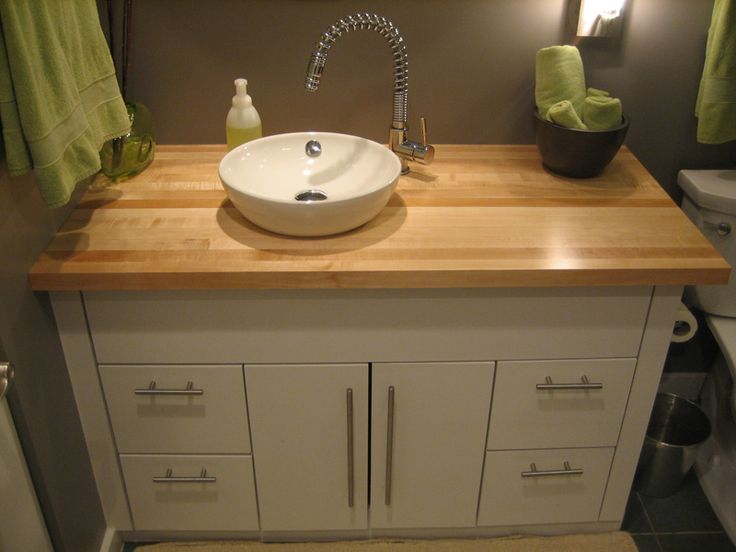 Bathroom Vanity w/ Butcher Block Counter top. Similar Pulls can be found here: http://www.vandykes.com/2-end-grain-butcher-block/p/209323/ Sink can be found here: http://www.vandykes.com/avanity-18-inch-oval-undermount-white-vitreous-china-sink/p/218195/