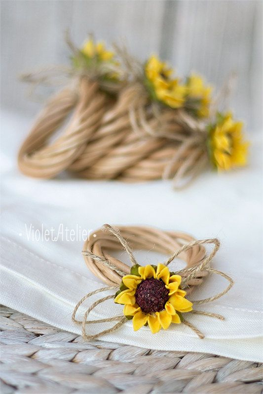 Set of 4 sunflower napkin rings, nice rustic touch to summer table, sunflower inspired weddings, rustic wood place settings and table decorations. Each ring is made of natural twisted wooden sticks. It is tied with twine and topped with small artificial sunflower. These rings work beautifully with linen napkins (as on the pictures) and rustic table decor. *Note the linen napkin is for photographic purpose only and it is not included in the listing. Approximate inner ring diameter 4.5 cm…