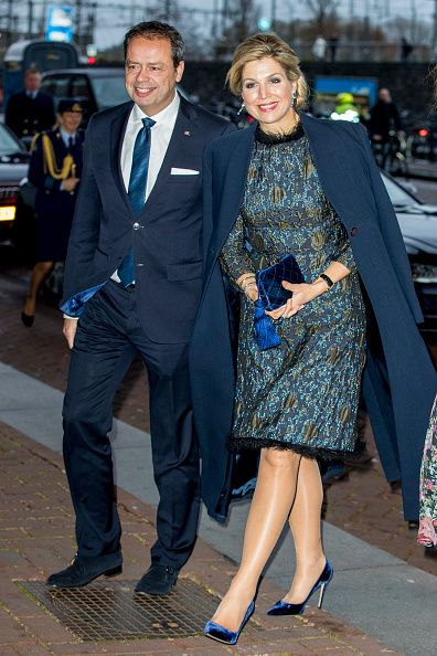 Queen Maxima of The Netherlands dazzle in shimmery midnight blue Natan gown with a feathered collar, wore her hair in loose chignon, she accessorize her looks with a pair silver drop earrings, some silver bangles, carried a velvet clutch bag and added a matching pair of vertiginous stilettos, the Dutch royal certainly made an entrance as she arrived at the Prince Bernhard Cultuurfonds Awards.