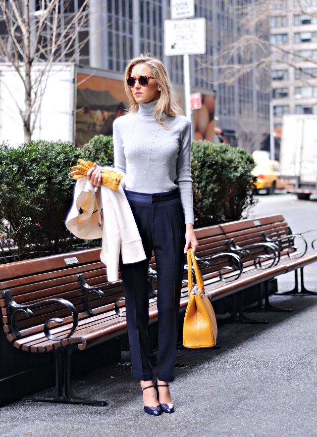 orange bag and leather gloves with office outfit