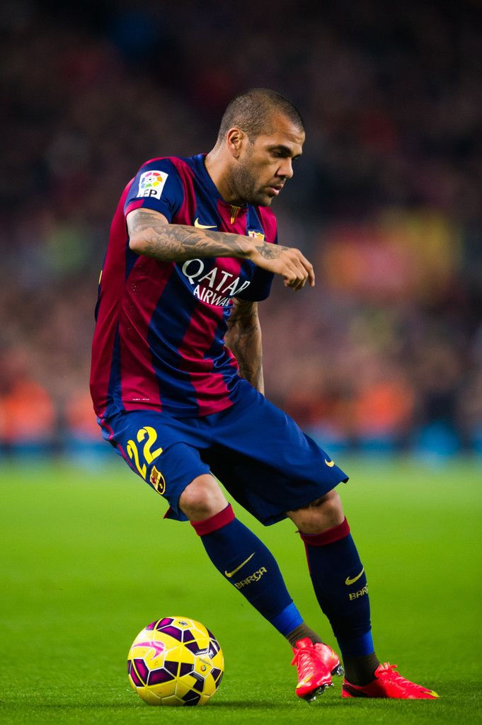 Dani Alves of FC Barcelona controls the ball during the La Liga match between FC Barcelona and Club Atletico de Madrid at Camp Nou on January 11, 2015 in Barcelona, Catalonia.