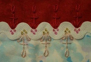 crazy quilting....(i love the sweetness of the beading detail!)....
