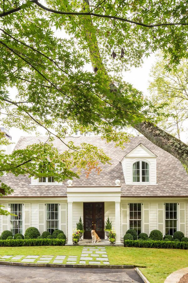 Never Enough Cottages - Best Houses of 2016 - Southernliving. At SL, we have an enduring love for white cottages – especially ones with adorable dogs waiting for us by the door designed by young architect Corbett Scott. This traditional home feels fresh with the white on white palette, boxwood balls, and the hopscotch-style front walk.