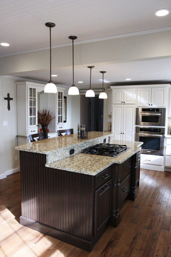 new venetian gold granite countertops dark kitchen island pendant lights hardwood flooring