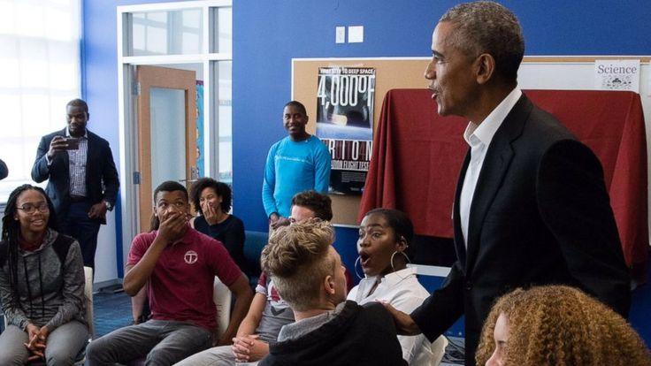 Barack Obama makes surprise visit to high school students
