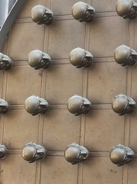 Heads on a door in Prague, Czech Republic. #Praha #Europe #Travel