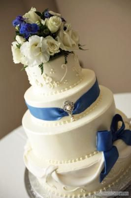 Blue and White wedding cake with flowers from Brookshire - Event And Wedding venues