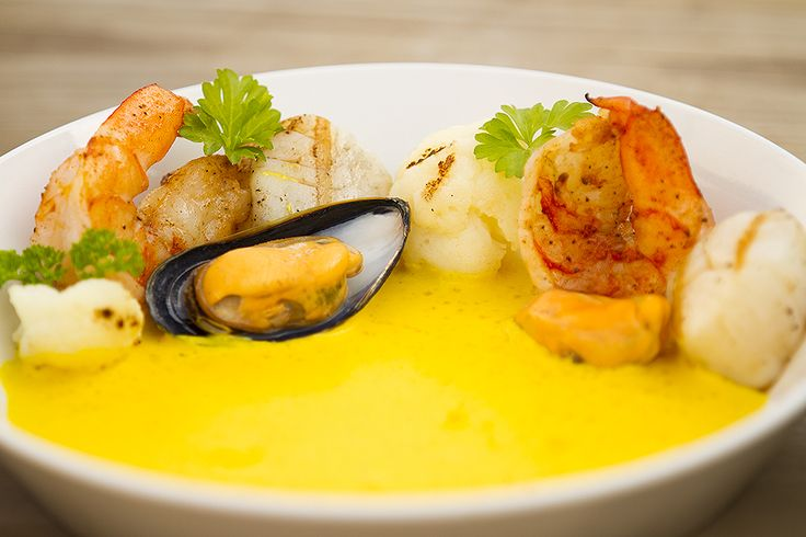 Grilled scallops, scampi & cauliflower with mussels and saffron sauce