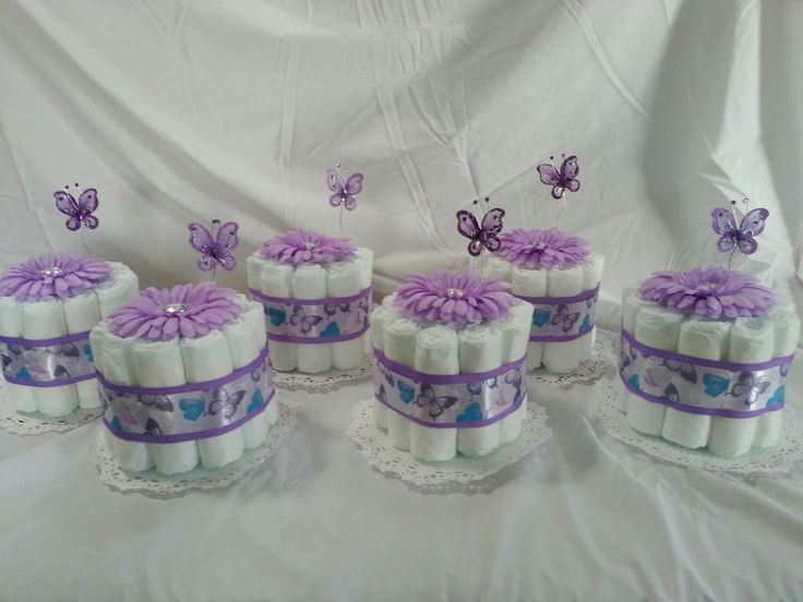 Purple, white butterfly diaper centerpieces.