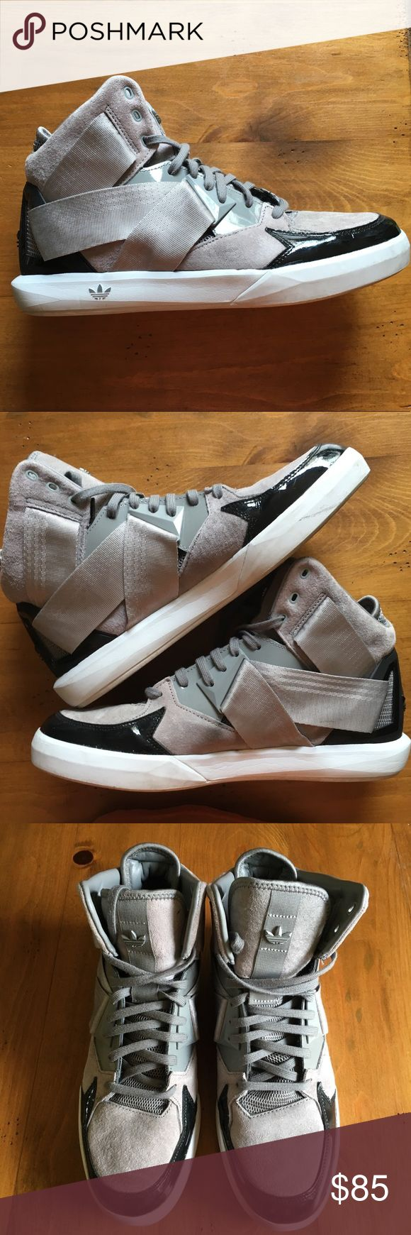 Adidas hi tops limited edition, grey & black Limited edition Adidas hi top basketball shoes are in great condition hardly worn. Mens size 9.5 Adidas Shoes Sneakers