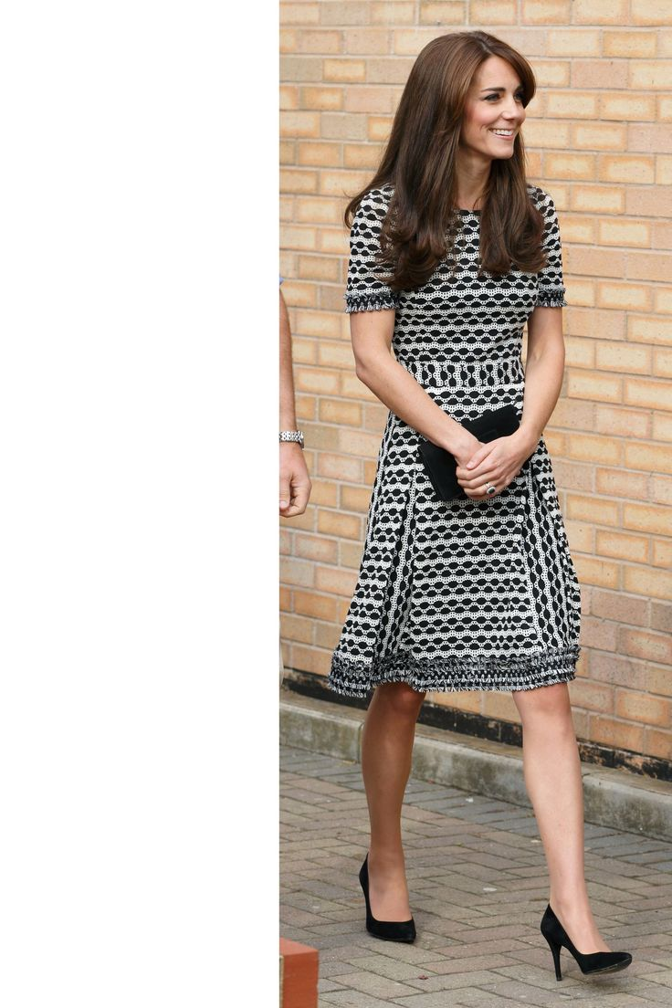 October 10, 2015 - The Duchess makes a public appearance for World Mental Health Day wearing a Tory Burch dress with simple black pumps and a clutch.