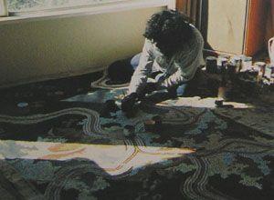 Picture: Clifford Possum Tjapaltjarri painting at Artspeak Studio Gallery 1990