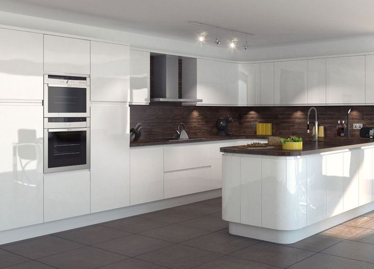 A modern, integral gloss white kitchen from Mackintosh.