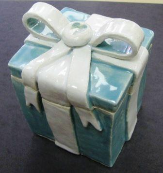 Clay box present - would make a cute cookie jar