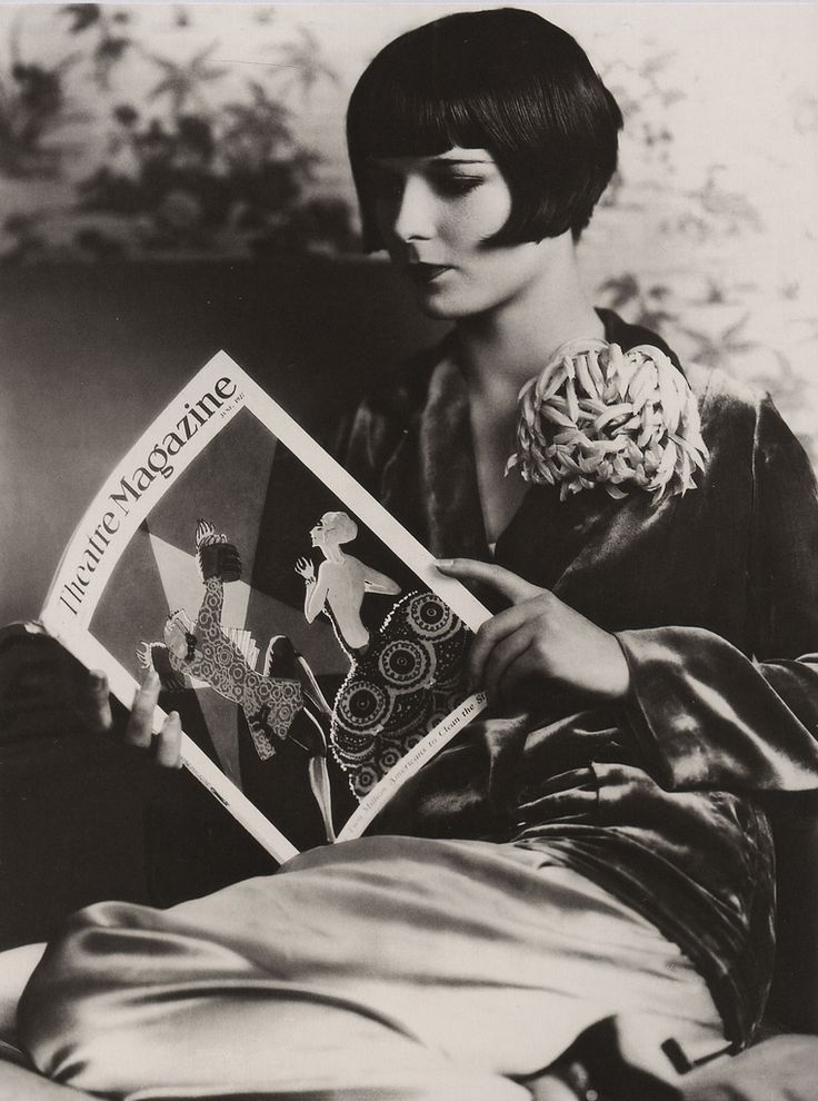 Louise Brooks reading Theatre Magazine (1927). Photograph by Eugene Richee. Brooks (1906-1985) appeared in 24 films between 1925 and 1938. She was also a gifted dancer as well as an accomplished writer. Before entering films, she performed with the Denishawn Dance Co. and Ziegfield Follies. Brooks is best known for her role as Lulu in the classic 1929 German film, Pandora's Box. Brooks is remembered for her independent spirit, remarkable beauty, and trademark hair style.