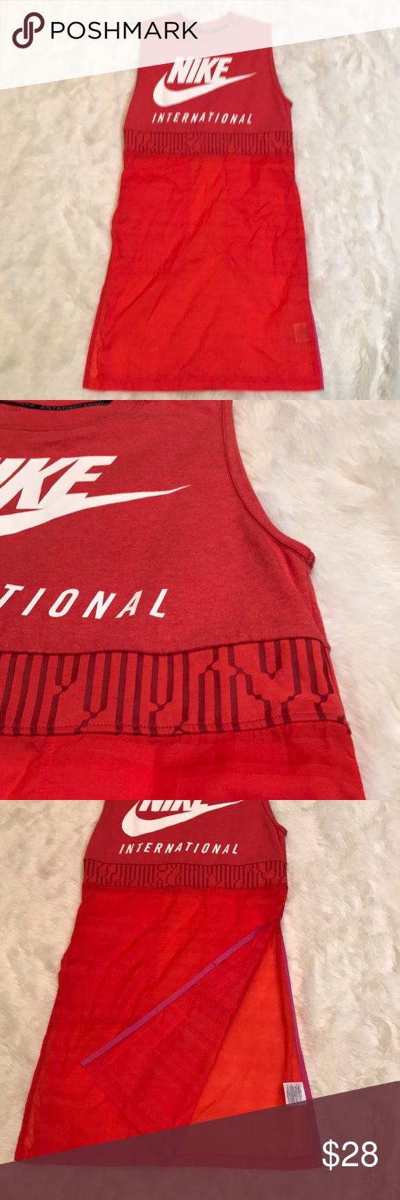 Nike International Tank Dress - Red - Size Small Nike International Tank Dress - Red - Size Small. Tank Dress is new without tags. Top is solid t shirt material and is recycled polyester and cotton blend. Transparent lower section is 99% recycled polyester and 1% other fibers. Has slots on the sides up to hip level (ie you need to wear something on the bottom). Black version shown for style only. Item for sale is red version. Nike Dresses