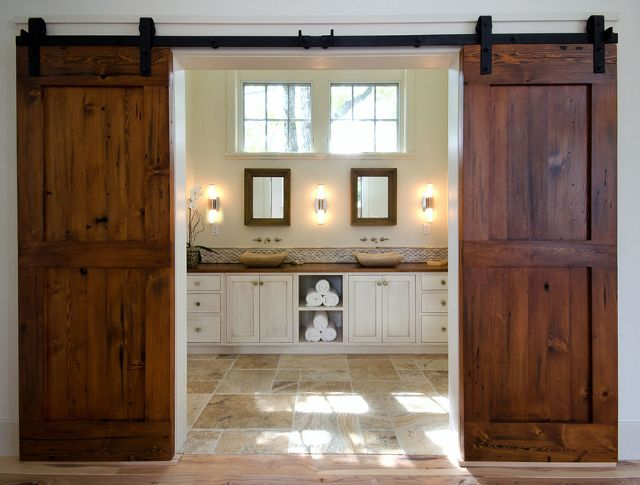 Bathroom barn doors were custom crafted by a local builder. The wood used was Reclaimed Douglas Fir, and the stain was Early American.