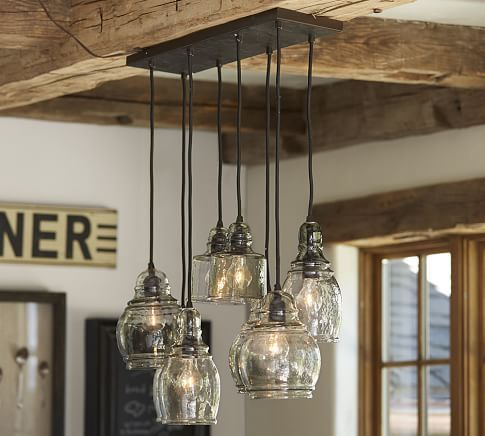 Paxton Glass 8-Light Pendant:mouth-blown glass in an eclectic shape and affixed to the wrought-iron frame