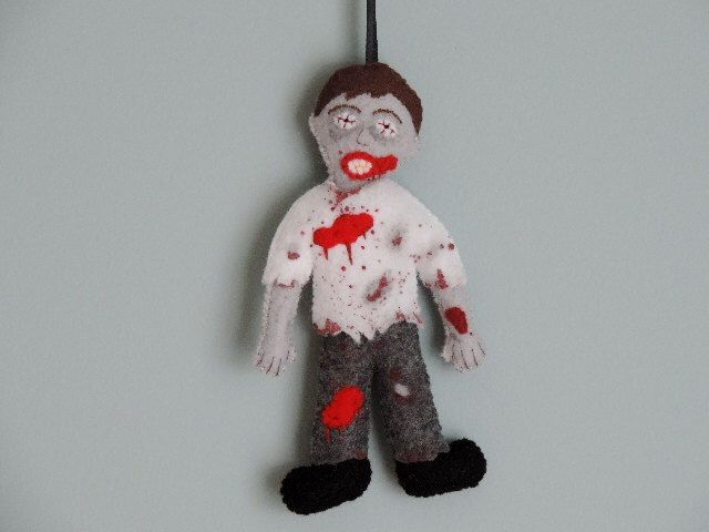 Zombie Felt Ornament (with gray pants) by KJWcrafts on Etsy https://www.etsy.com/listing/268266956/zombie-felt-ornament-with-gray-pants