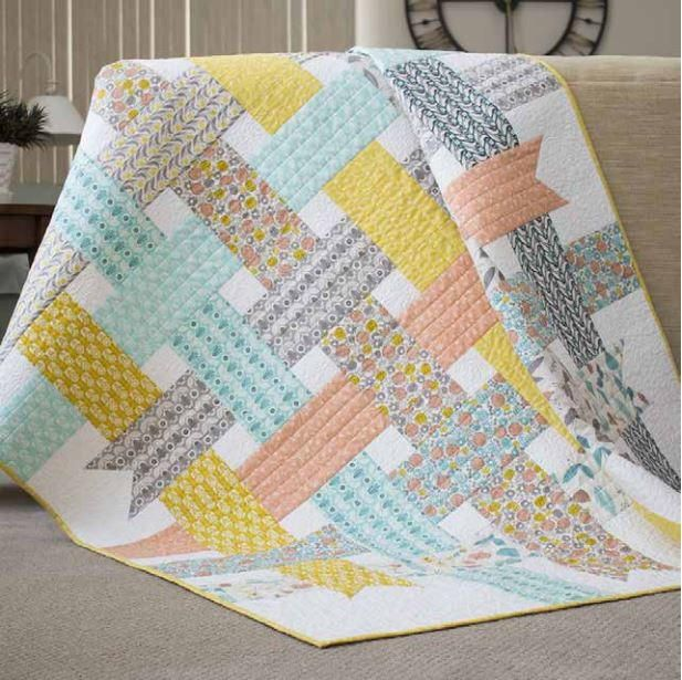 Create a sweet baby quilt inspired by Scandinavian traditions with this free quilt pattern. This Nordic Ribbons Baby Quilt Pattern embodies all things girly and puts a modern spin on basketweave quilt patterns.