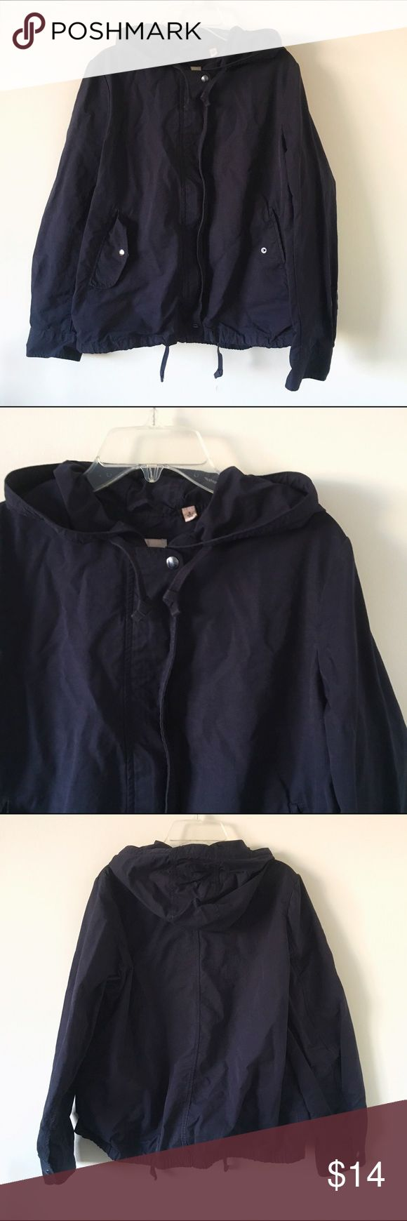 Uniqlo Navy Windbreaker Jacket A navy windbreaker-style jacket with hood, perfect for fall weather. Two outside pockets with buttoned flaps. Super cozy with a brushed feel to the fabric. Uniqlo Jackets & Coats