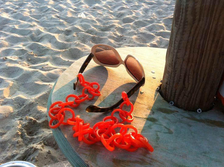 Orange plastic eyeglasses chain. Unique accessory.