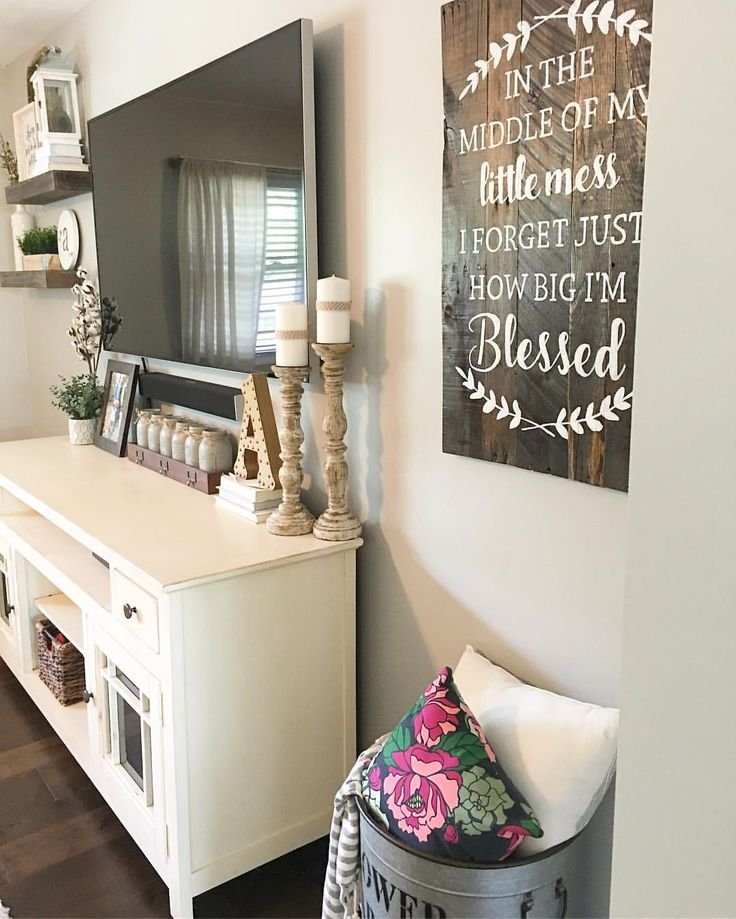 Split level living room, living room decor, farmhouse decor, farmhouse style, rustic decor, modern farmhouse, target decor, Hobby Lobby decor, living room Remodel, fixer upper, candlesticks, tv console decor, tv display, floating shelves, wooden sign, tv decor, See Instagram photos and videos from Robin Norton (@rock.n.robs)