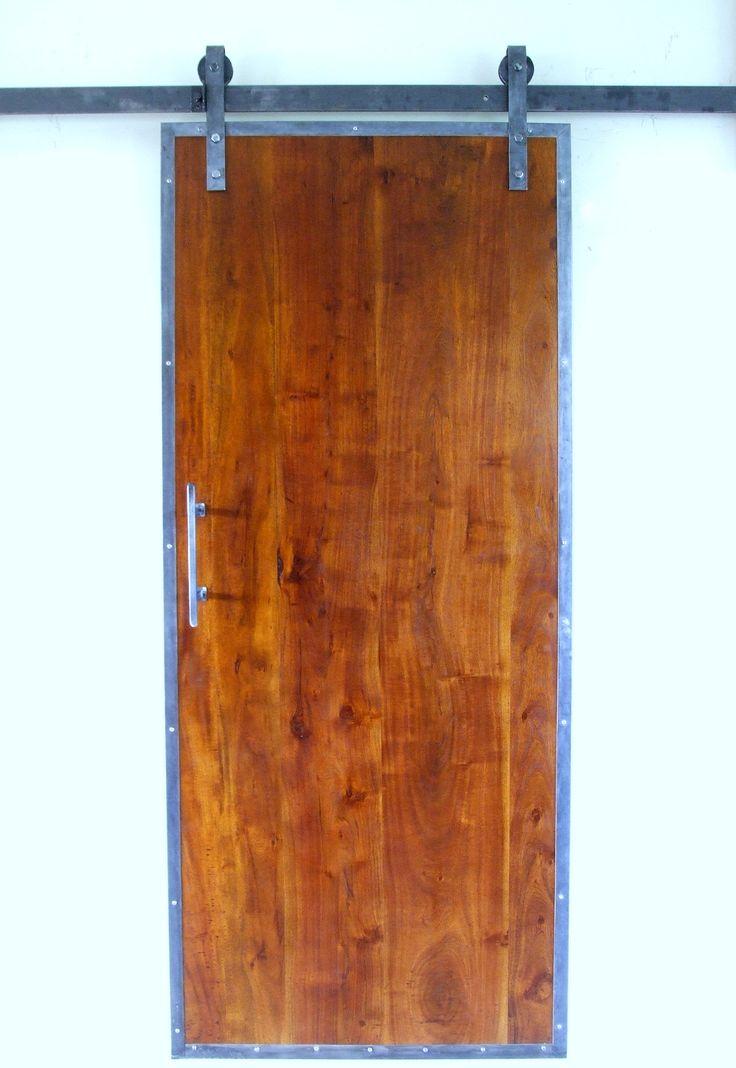 Drzwi na Sprzedaż  Drzwi wraz z systemem przesuwnym wykonane z egzotycznego drewna oraz stalowej ramy i systemu przesuwnego .Wymiary 90 cm x 210 cm
