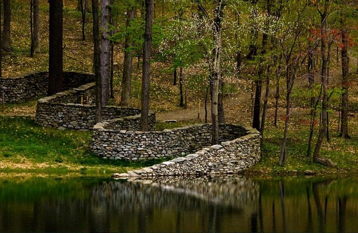 Storm King Wall in Mountainville, New York. The  2,278 foot snaking wall plunges into a pond but reemerges on the other side. By Andy Goldsworthy, 1997
