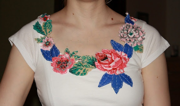 cut out designs from printed fabric - applique around neckline, add beads