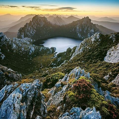 This is the view from the climb up to Mount Sirius in the Western Arthur range in @Tasmania. Lake Oberon can be seen 300m below and in the distance the eastern peaks of the range rise into the sky. A truly memorable sight to watch the sun rise over this range.