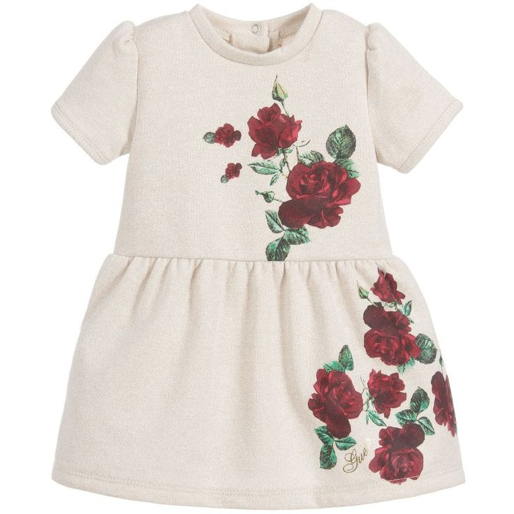 Designed by Guess, this baby girls ivory gold dress, has a pretty red rose print. There is a fitted bodice and gathered skirt, with popper fastening at the back and comes with a pair of cotton knickers.