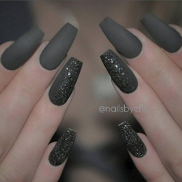 Matte colors, although without the shine, could look fashionably better especially on long nails. Here's a matte black set of nails with little black glitters for accent.